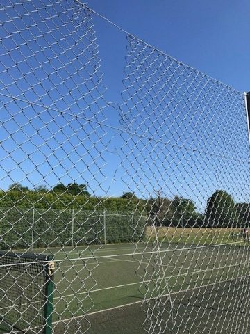 Tennis court fence vandalism