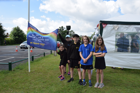 Melton Primary School children with the NHS flag
